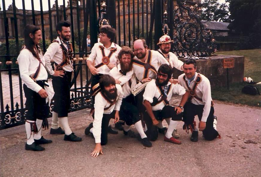 Brighton morris dancers c1987 standing outside iron gates
