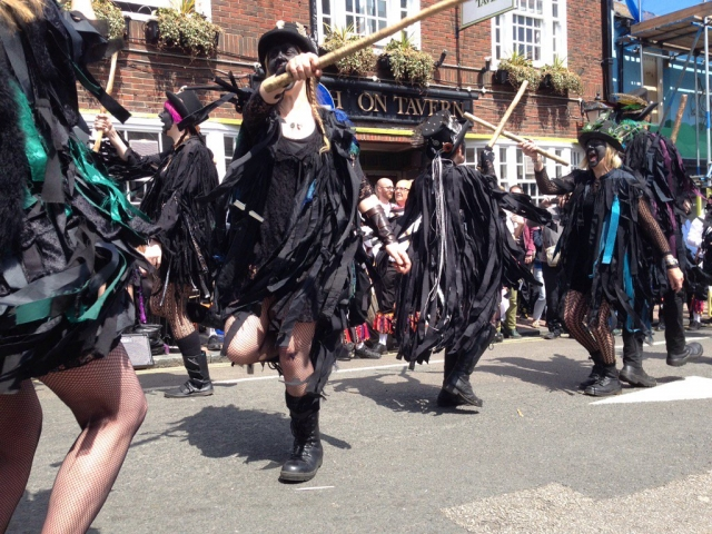 Border morris dancers with black rags and sticks