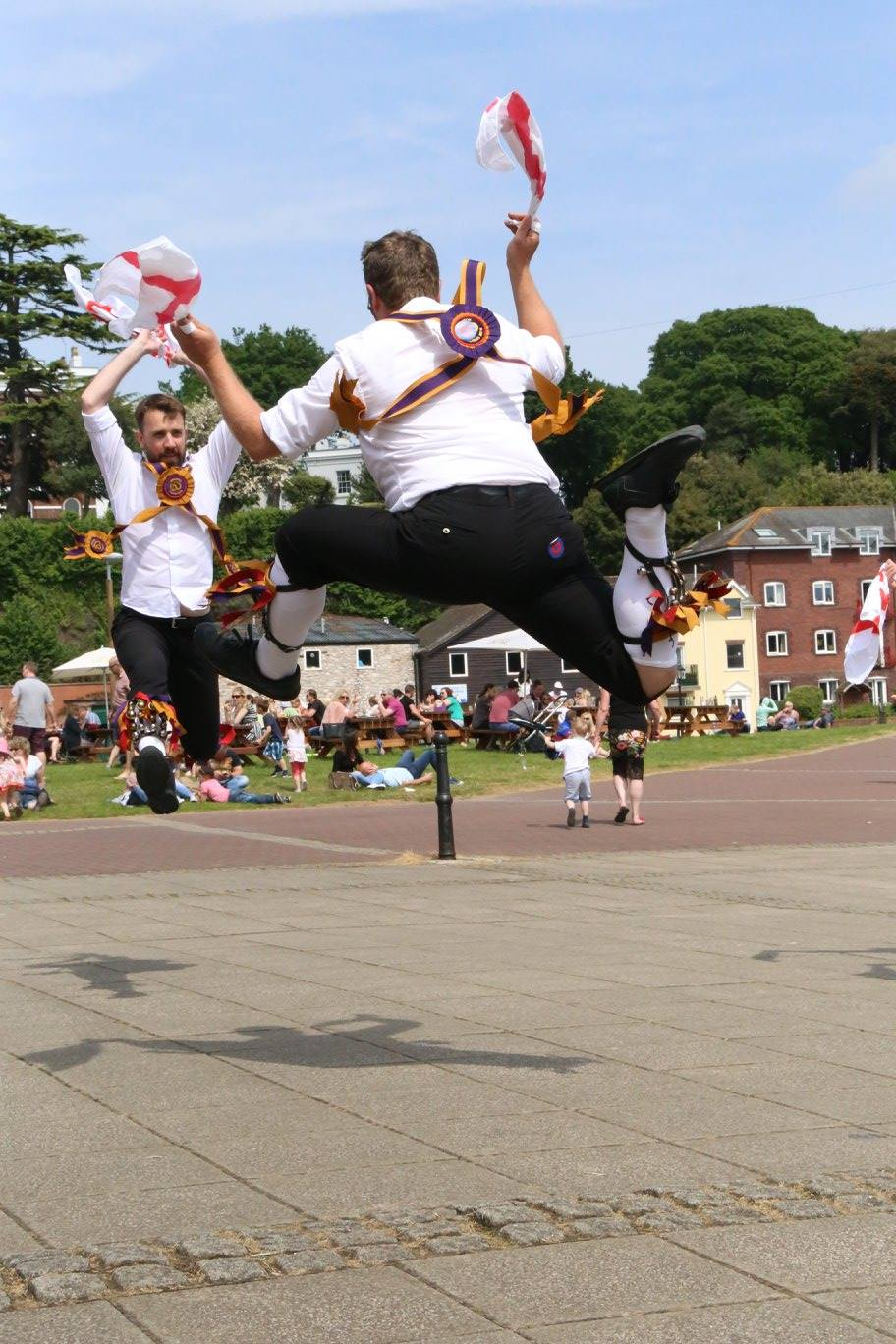 Two dancers jumping high