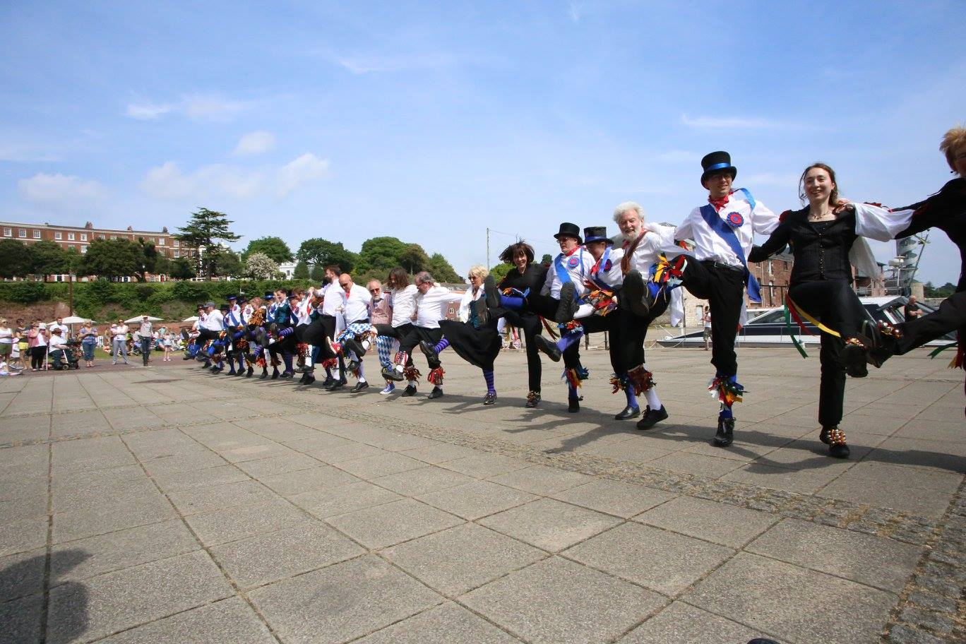 Group of morris dancers in a line, dancing