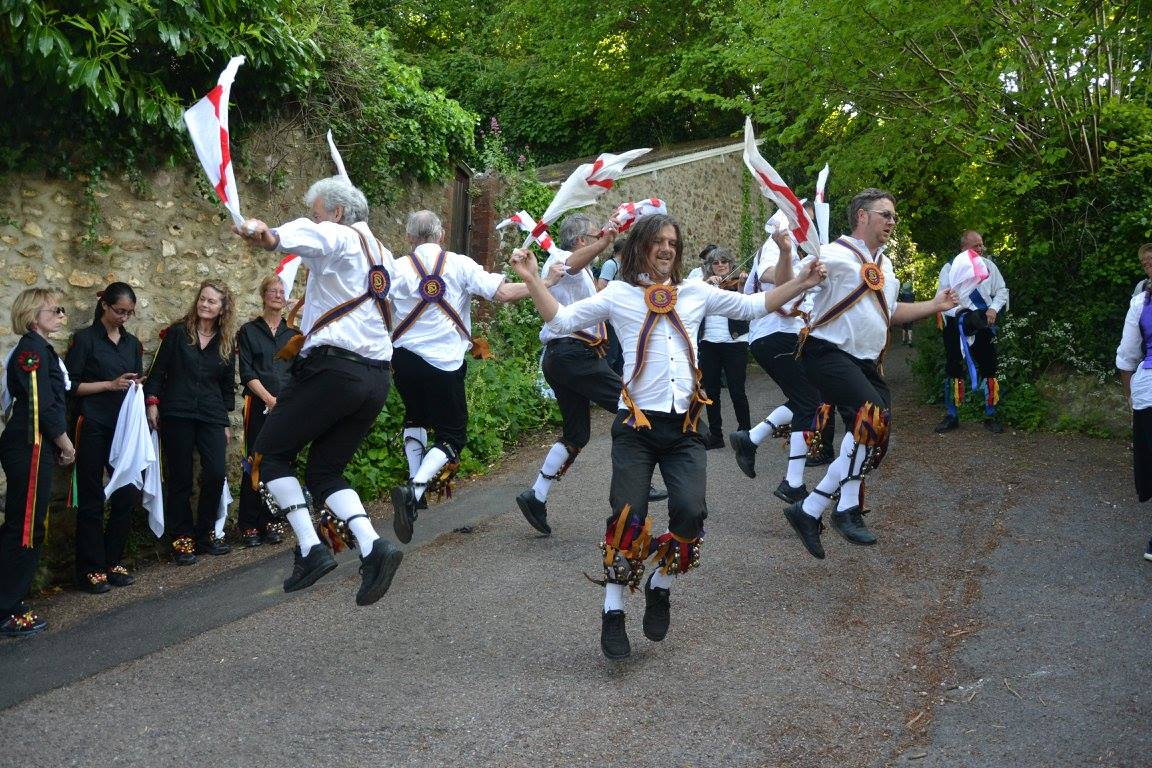 Brighton Morris dancing on a steep slope