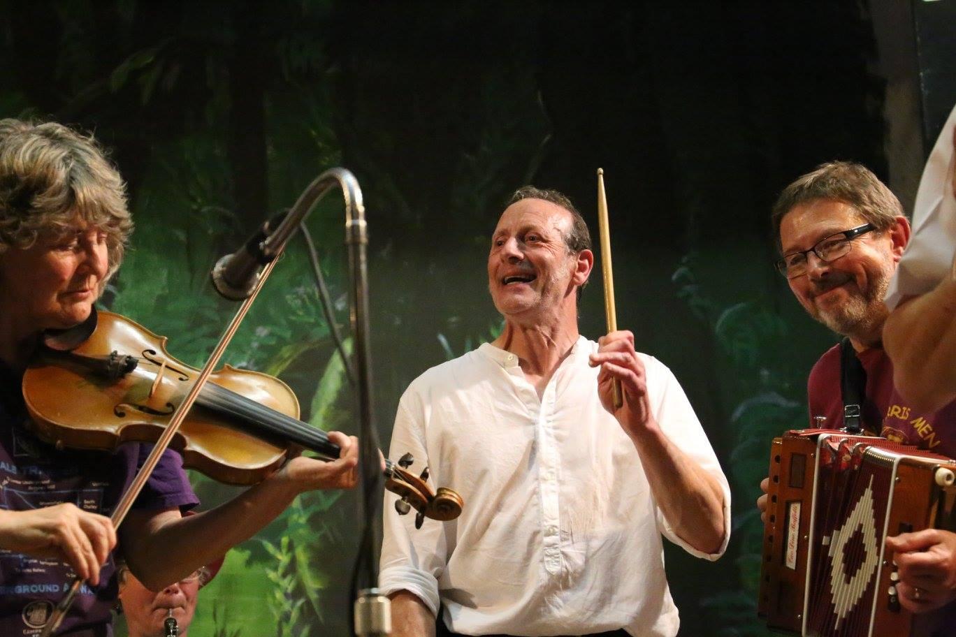 Three musicians on stage