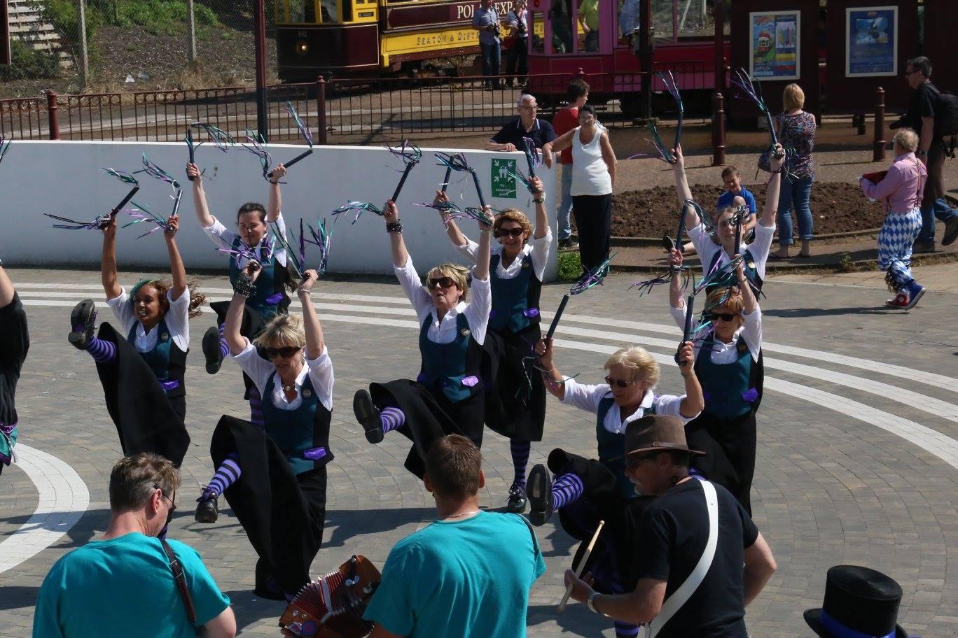 Customs and Exiles dancing at Seaton tram stop